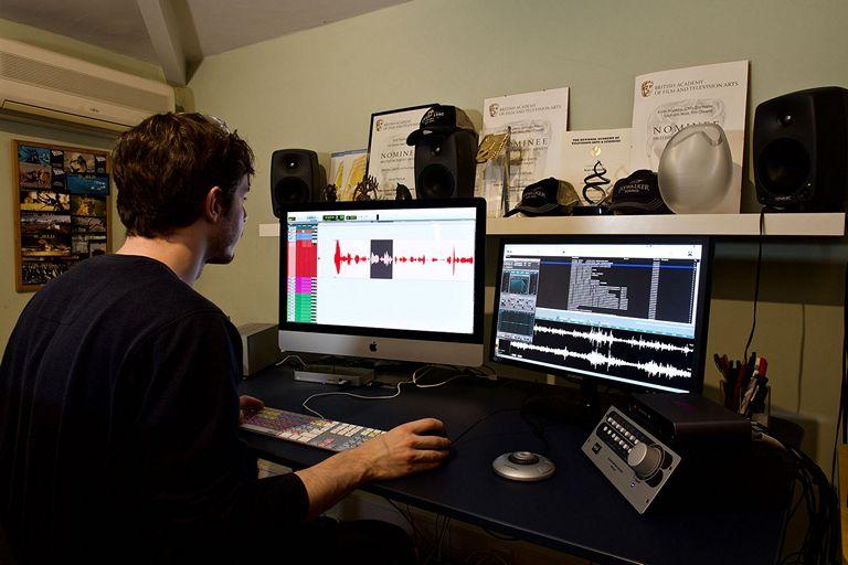 Sound Editor Working In Sound Editing Room